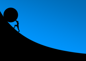 Man pushing a stone up a slope